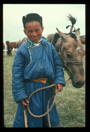 Mongolian boy with horse, met on a previous expedition. (Photo by Robert Peck)